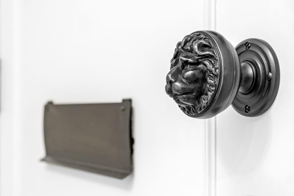 Black Lion Faced Door Handle White Door