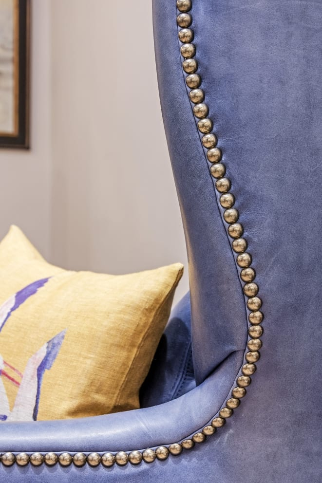 Blue Leather Studded Arm Chair Yellow Pillow