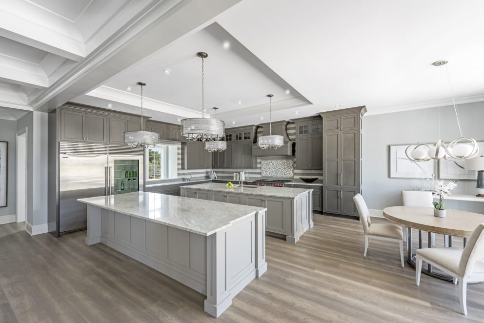 Dark Gray Cabineted Kitchen Two Marble Top Islands Dinning