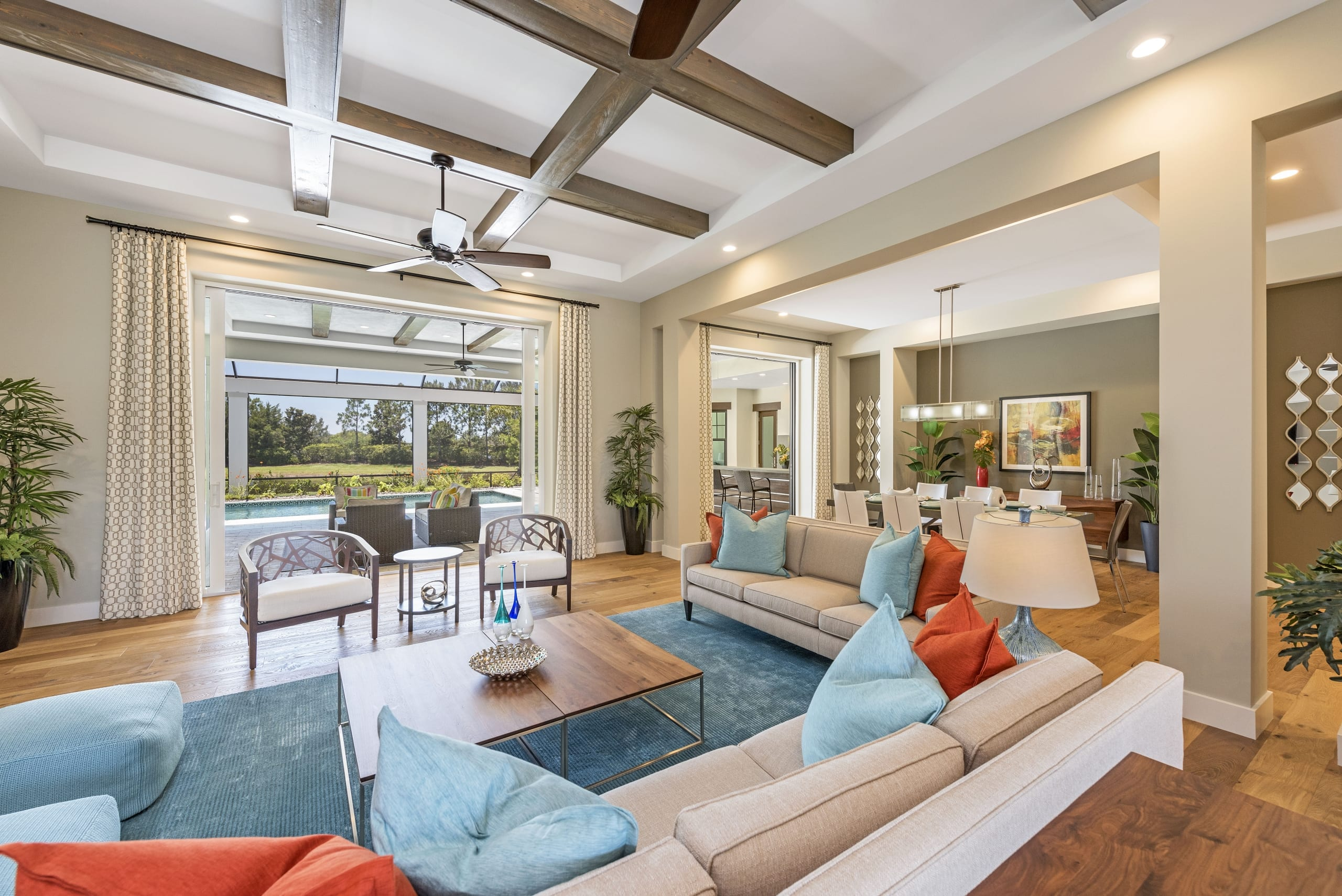 Dark Wood Beams Contemporary Livingroom Swimming Pool Deck Dinningroom Blue Red Cushions Wood Floor Rug