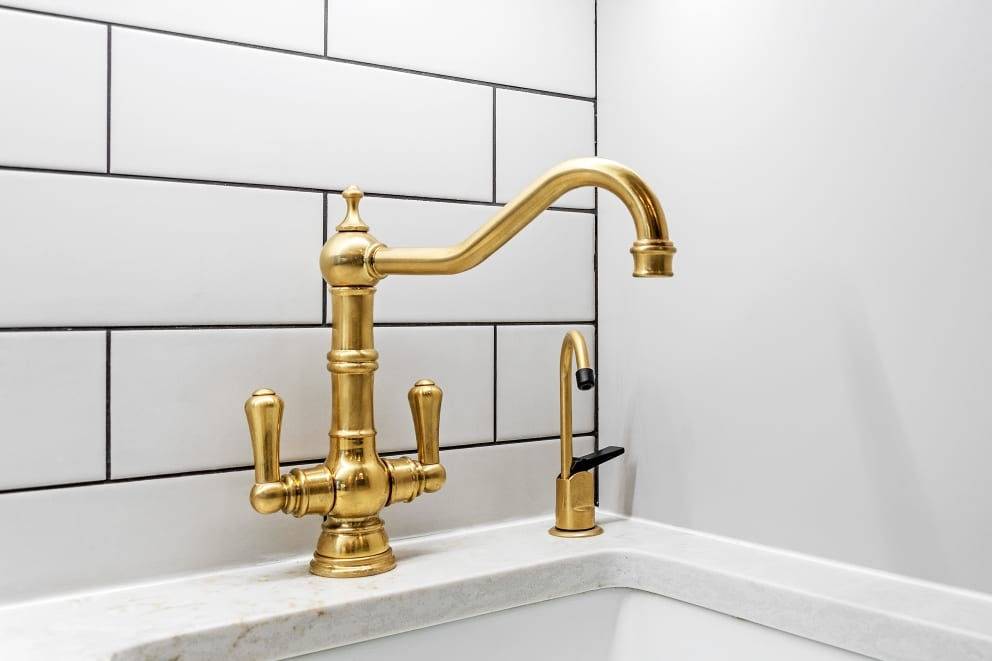 Gold Faucet White Wall Tiles