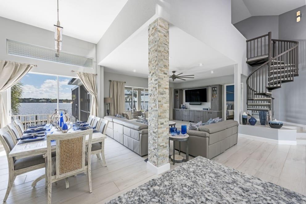 Open Plan Dinningroom Livingroom Spiral Staircase Gray Walls