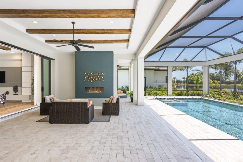 Tiled Stone Pool Deck Wood Beamed Fan Dark Green Walled Fireplace Outside Cushion Funiture