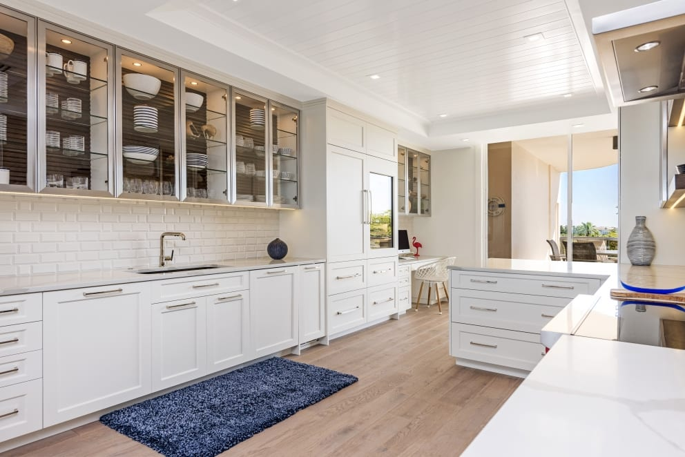 White Marble Counter Top Glass Cabinets Blue Rug Wood Floor
