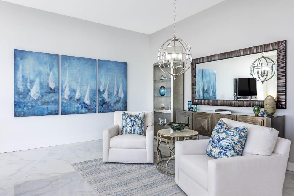 Meg Krakoviac Sail Boats Trio Blue Paintings Biege Arm Chairs Marble Floor