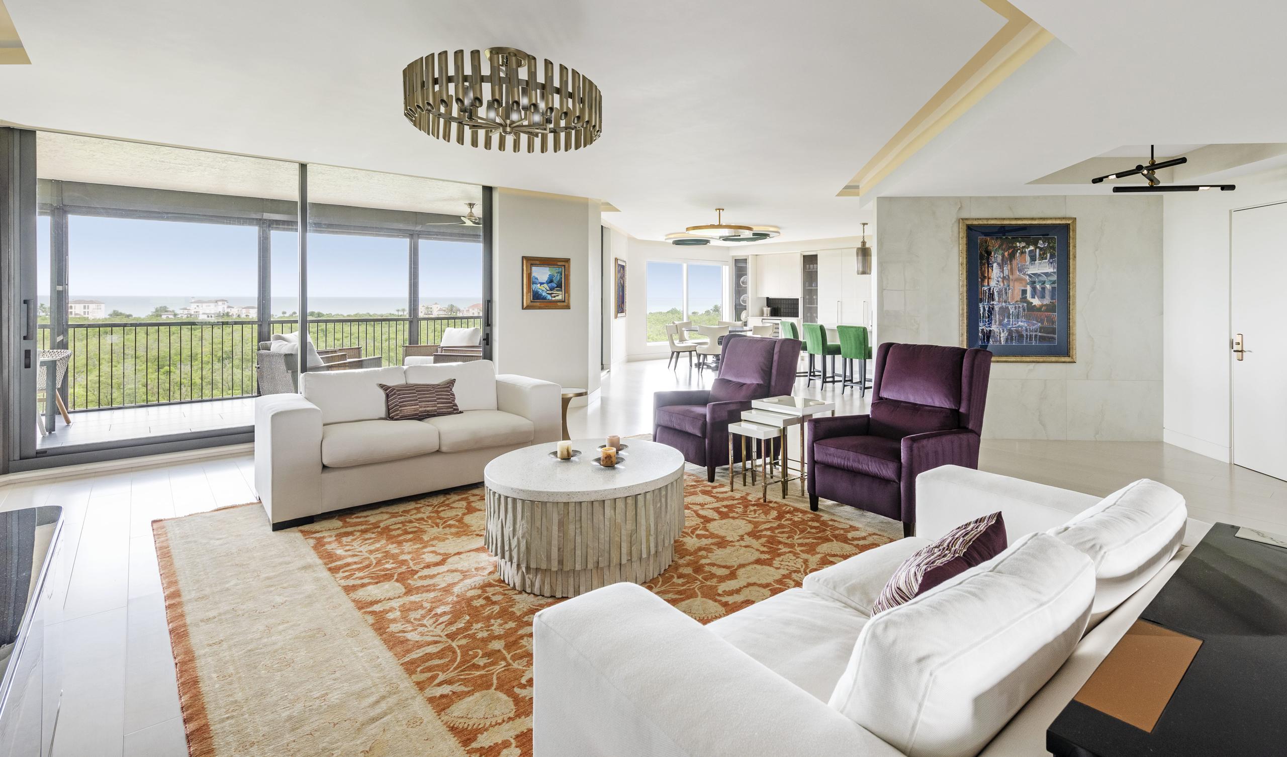 White Livingroom Gold Light Fixtures Orange Rug