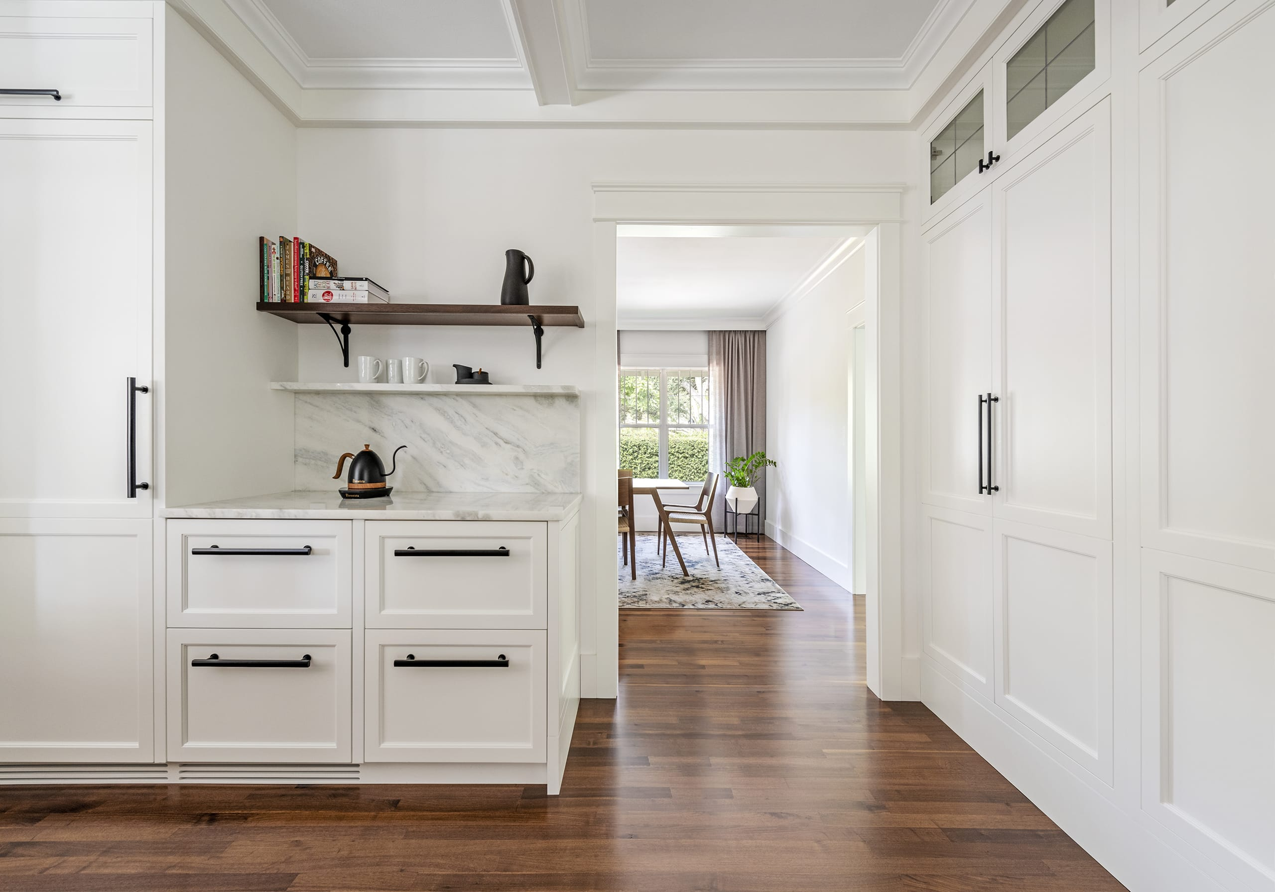White Cabinets Marble Counter Top Wood Floors Dining Room