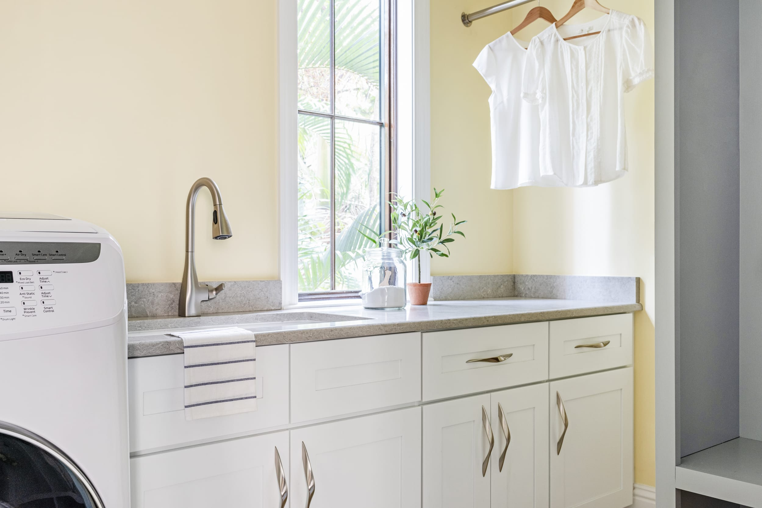 Yellow Laundry Room White Cabinets