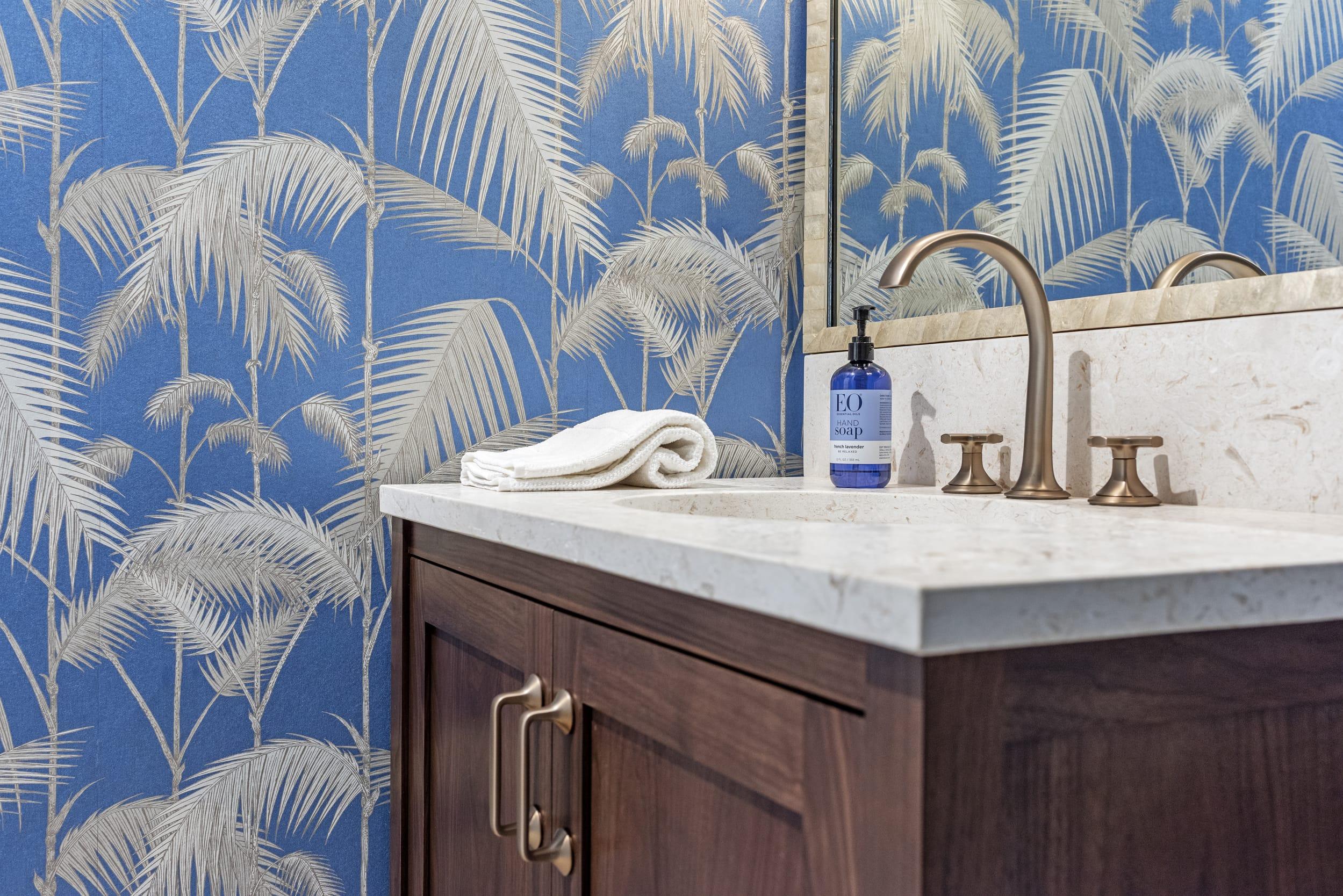 Jeffrey Fisher Home Dark Wood Cabinet Stone Sink Gold Fosset Blue Fern Wall Paper