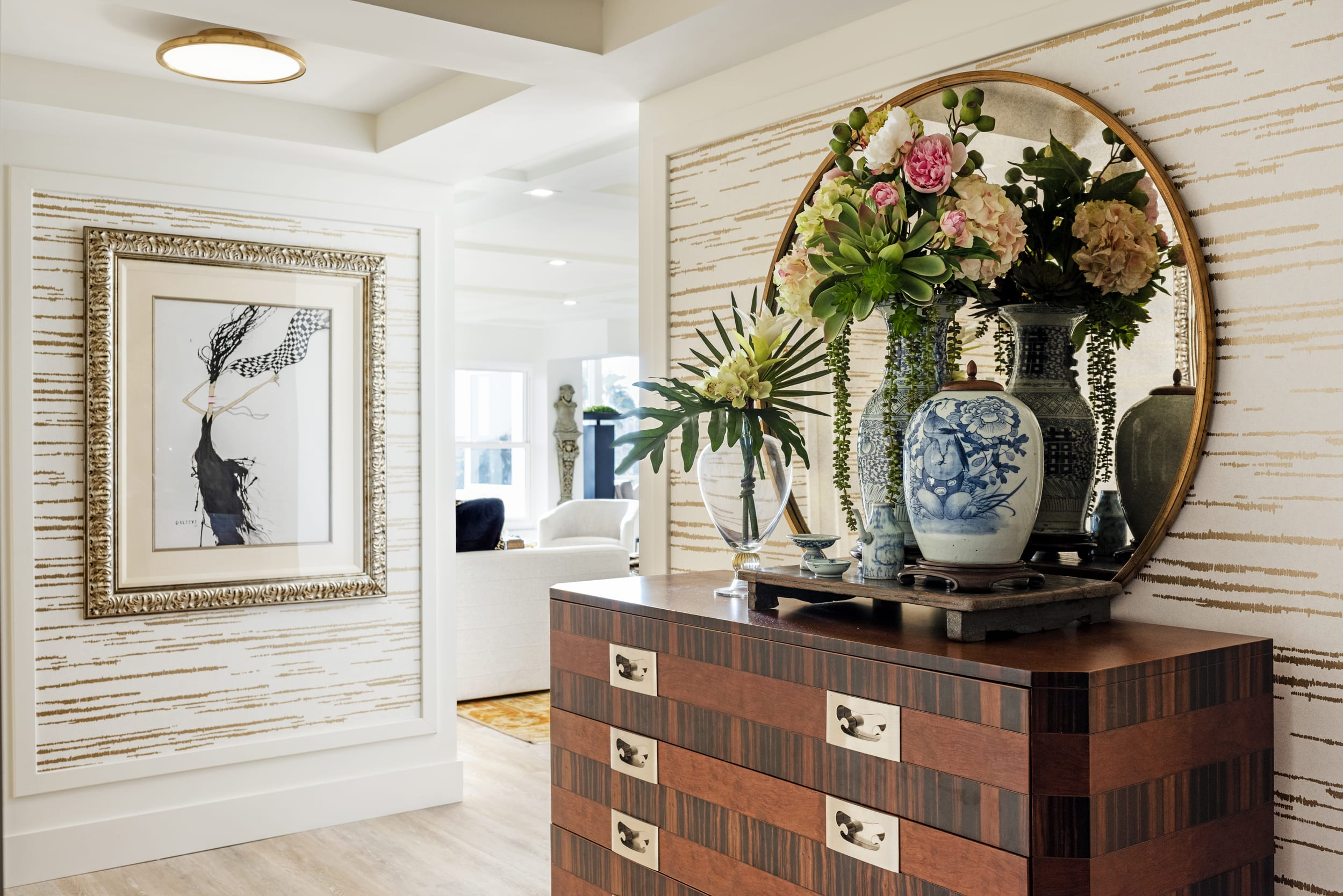 Floral Entry Textured Wood Chest Of Draws Gold Lined Wall Paper Gold Framed Art Work