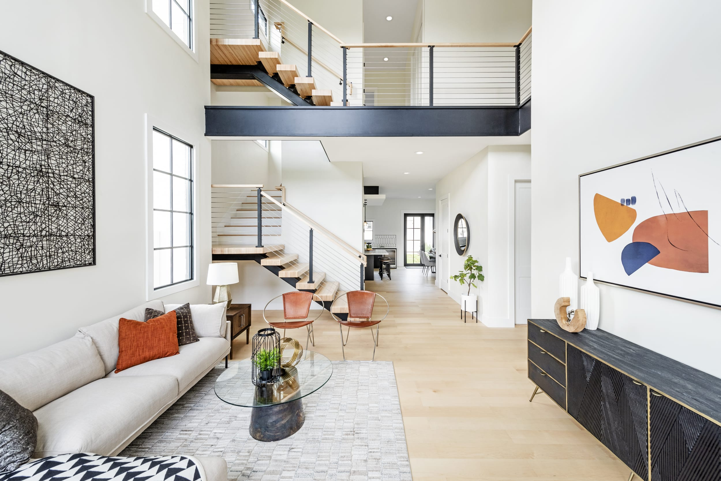 White Contemporary Livingroom Open Plan Split Level Black Accents Stairwell