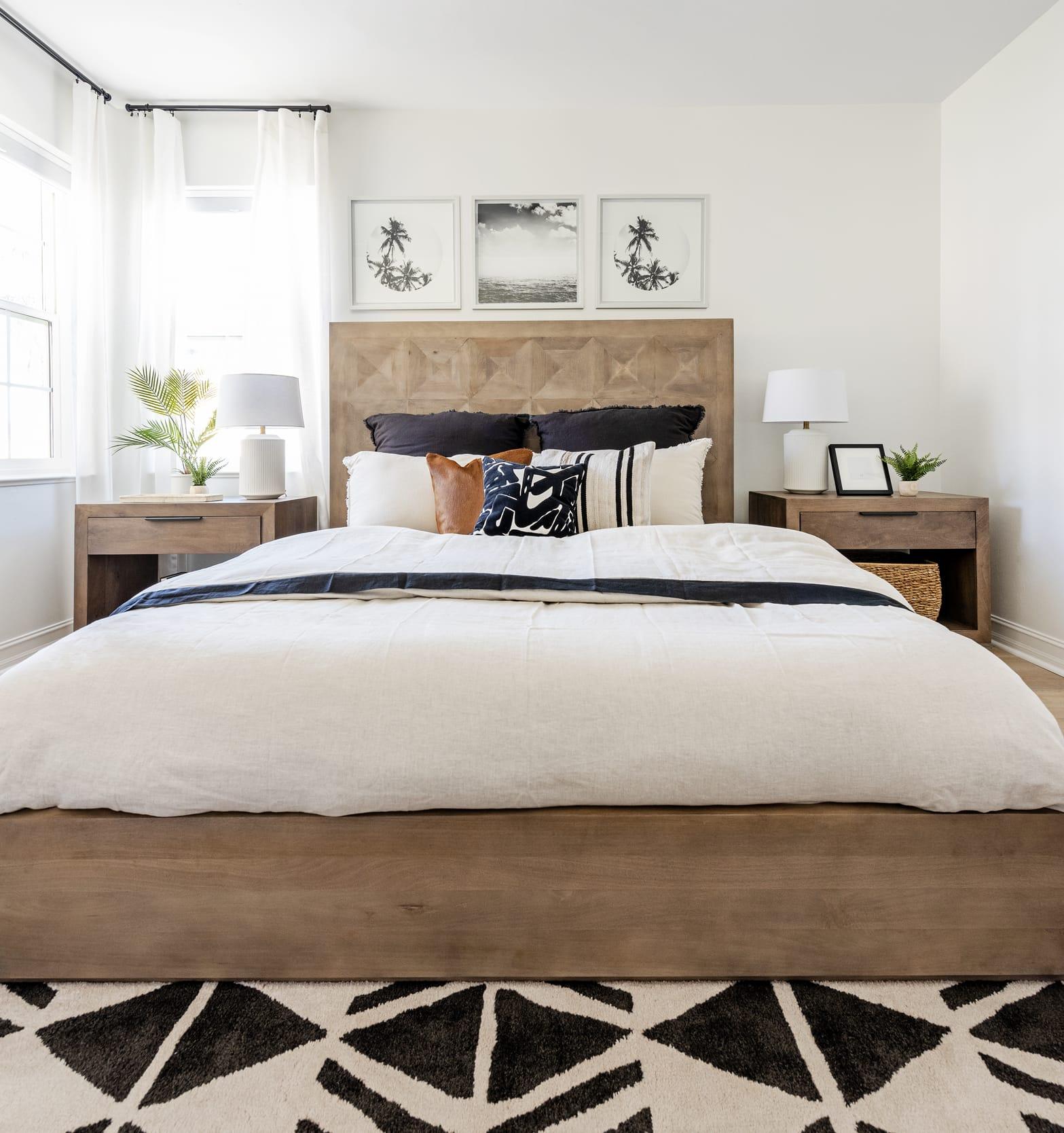 Bedroom Beige Black Bedsheets Rug Pillows Wood Dresser Headboard Head On