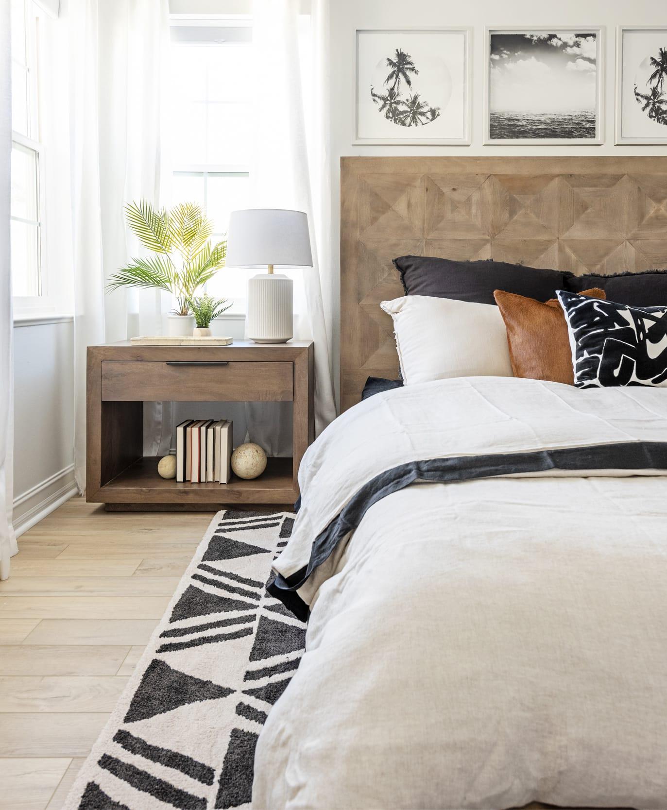 Bedroom Beige Black Bedsheets Rug Pillows Wood Dresser Headboard