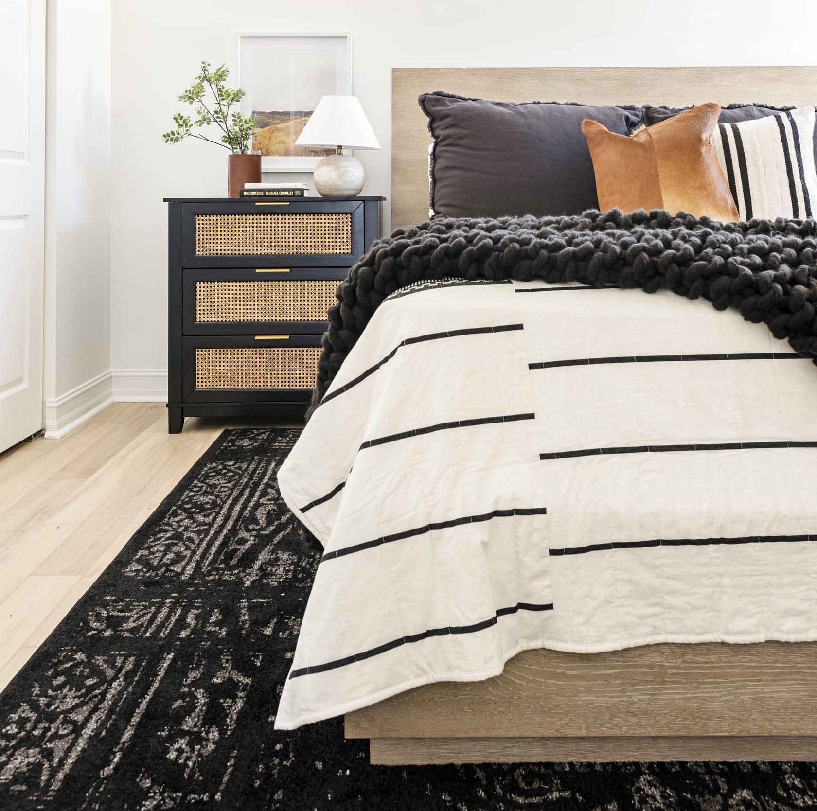 White Bedroom Black Rug Pillows Cow Skin White Black Pin Strip Bedsheets Wicker Faced Dresser Crop
