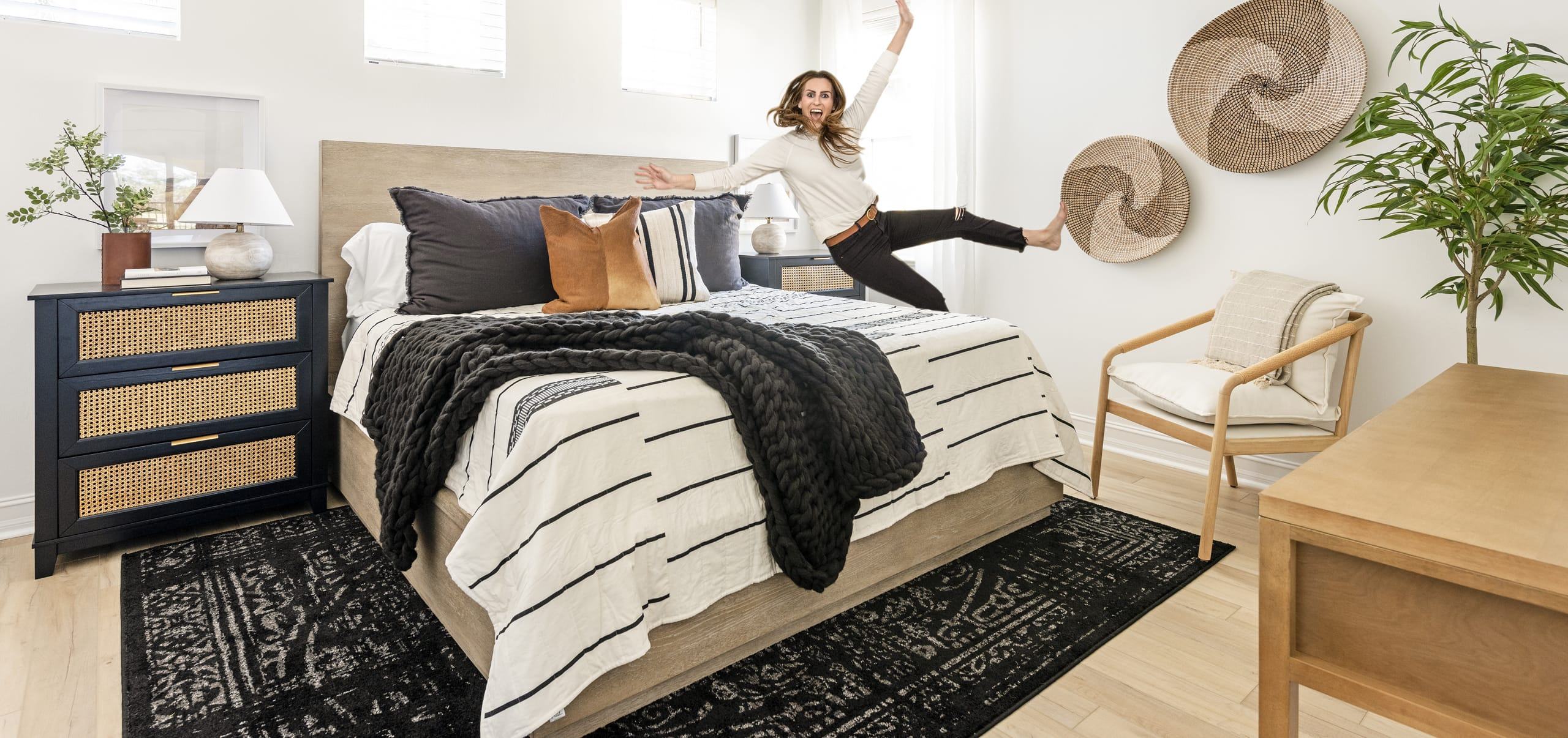 White Bedroom Black Rug Pillows Cow Skin White Black Pin Strip Bedsheets Wicker Faced Dresser Jump On Bed