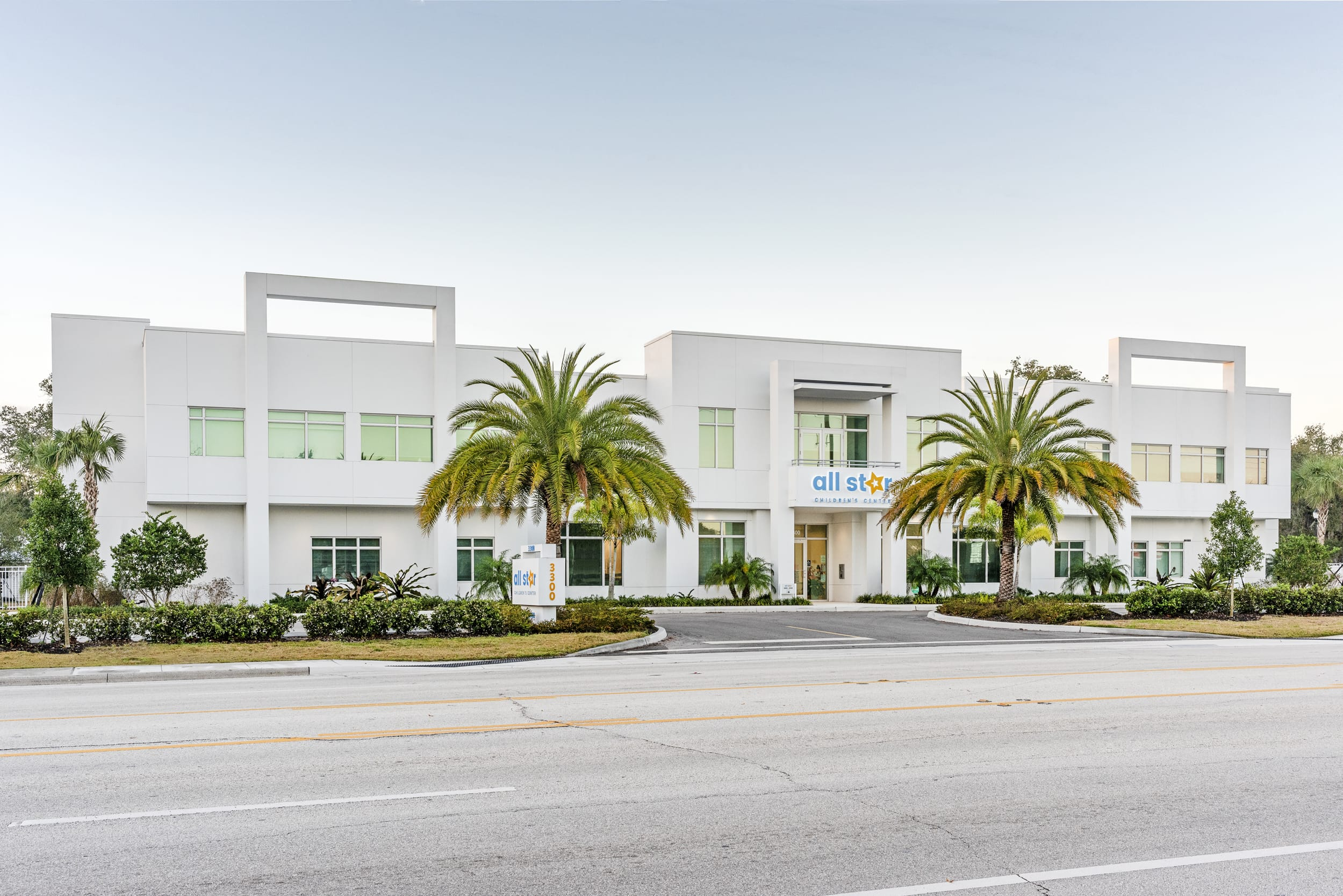 All Star Children's Center Full Exterior Palm Trees White Contemporary