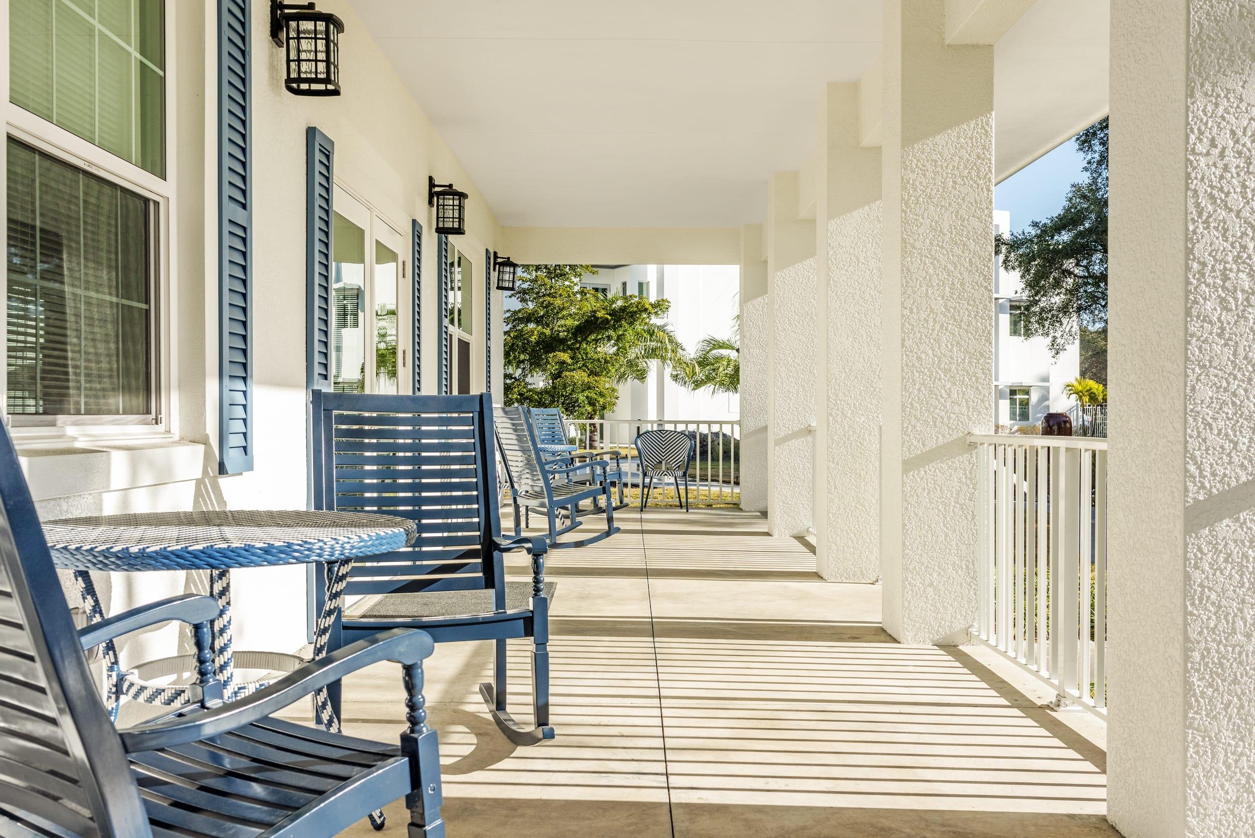 Blue Porch Chairs Shaddow Of Railings