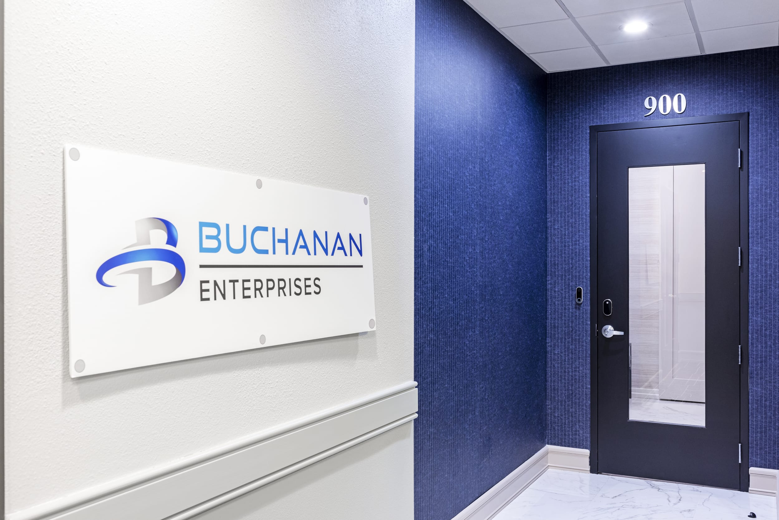 Buchanan Enterpises Sign Blue Pin Striped Wall Paper Blue Framed Door With Glass Panel