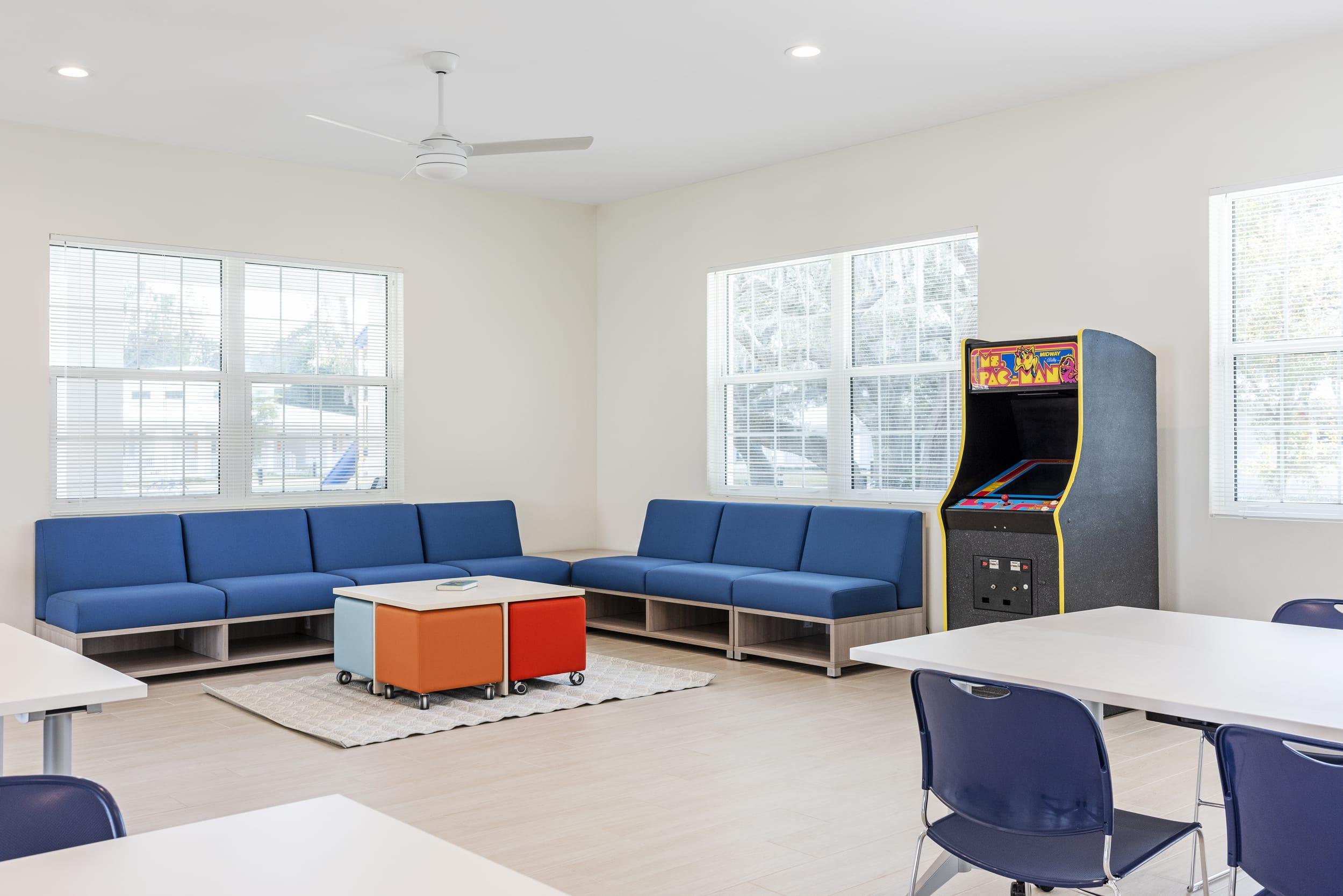 Games Room Blue Cushion Chairs Pac Man Arcade Machine