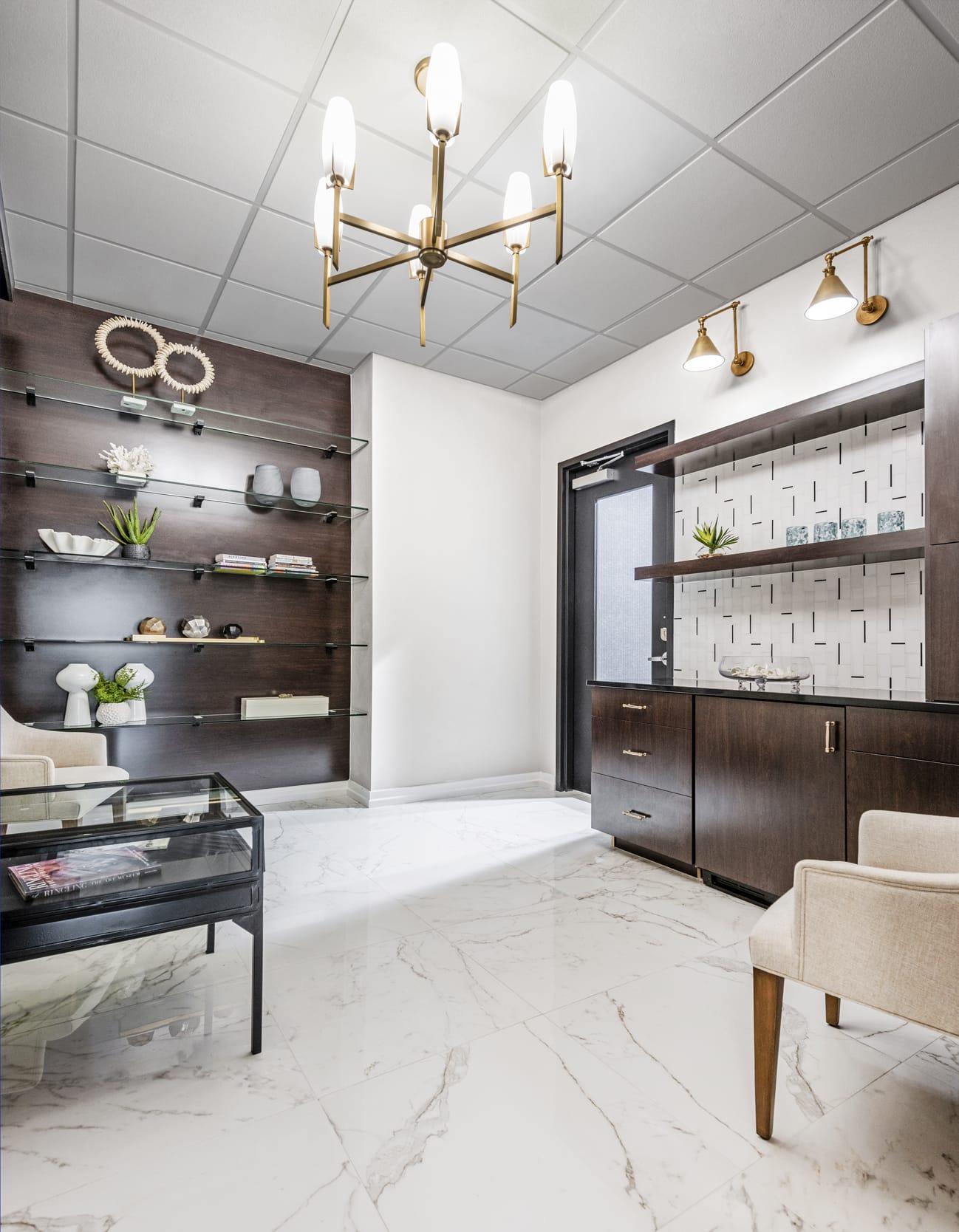 Office Waiting Room Hazelnut Cabinets Brass Light Fixtures White Marble Tiled Floor