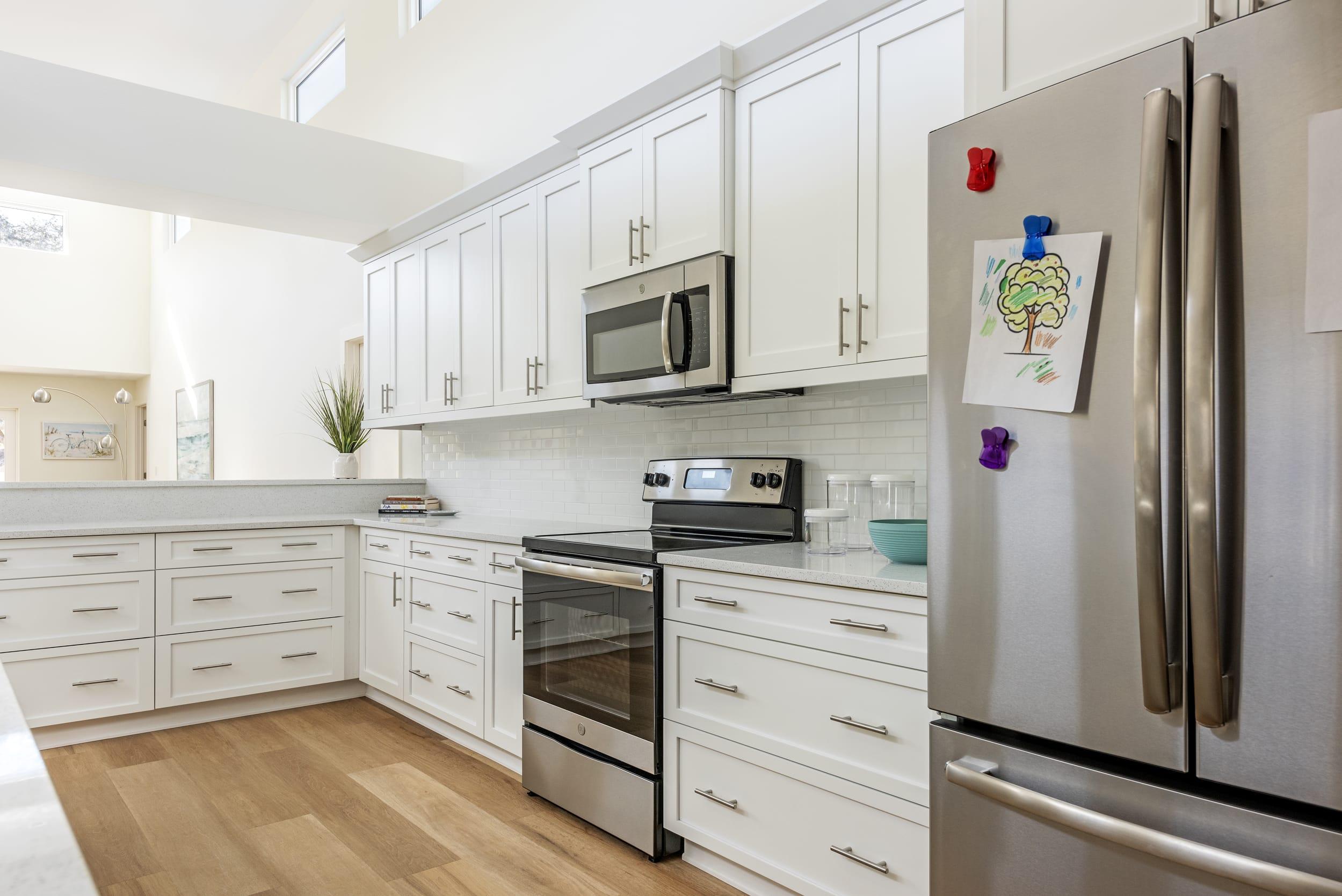 White Kitchen Cabinets Metalic Cooker Refrigerator